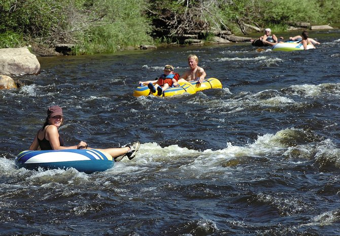 City of Steamboat Springs and Colorado Division of Wildlife officials continue to grapple with issues related to summer tubing on the Yampa River. Both entities say additional regulations may not be necessary.