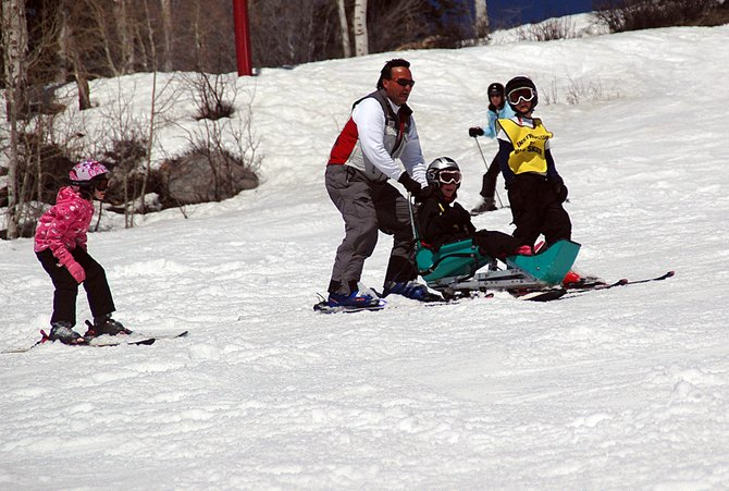 Julianna King, left, Jim Sittlington and Iain Grant ski down a run Sunday at Steamboat Ski Area with Ellie Zwak. They all were participating in the Stars of Tomorrow Youth Ski & Ride Camp, a three-day affair that was the joint effort of Steamboat Adaptive Recreational Sports, Access Anything and Adaptive Adventures.