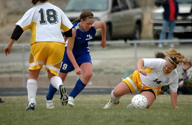 Moffat County High School junior Anastasia Todd puts the moves on a defender during the 2008 season. Todd and the Bulldogs competed Monday in Palisade - the team's fourth consecutive road game to begin the 2009 season.