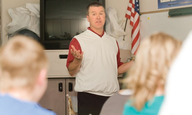 Steamboat Springs High School social studies teacher Bob Stahl talks to his class about post-Civil War America during his class Tuesday afternoon. District administrators anticipate employee salaries to be frozen for the 2009-10 school year. However, teachers will be allowed step increases based on experience.