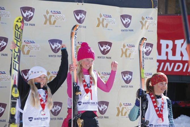 Serina Kidd, left, and Chandler Sedberry, middle, both of the Steamboat Springs Winter Sports Club, celebrate after a giant slalom event at the J4 Junior Olympics in WInter Park. Sedberry finished first, and Kidd finished second.