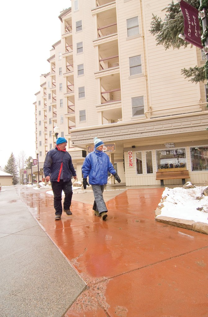 Kevin, left, and Sue Bramley walk though Torian Plum Plaza on Wednesday afternoon. Torian Plum's condo owners group sued Connell Resources in 2007, saying the plaza's concrete was flaking away.  The parties in the case settled March 13.