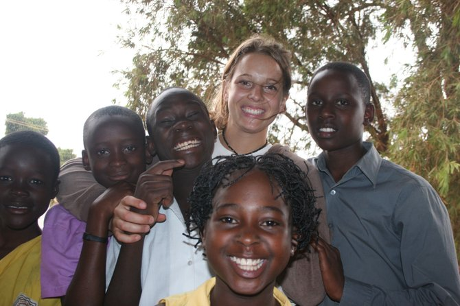 Come, Let's Dance administrative team member Julie DeBoer with some of the Ugandan children aided by the organization. The group holds a fundraising concert featuring Denver blues singer Hazel Miller.