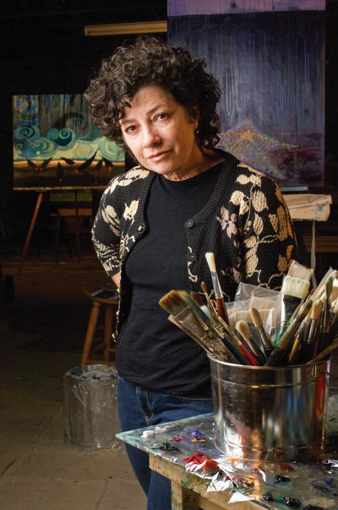 Artist Susan Schiesser inside her studio in west Steamboat Springs. Schiesser has started painting using glitter in her work and has become involved in the nonprofit group Kids Matter International.