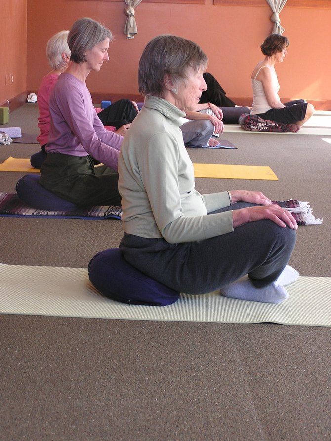 Yoga students focus on relaxing at the beginning of the Yoga for 50 and Better class at the Yoga Center of Steamboat. More older adults are experiencing a renewed sense of wellbeing and many other health benefits through yoga practice.