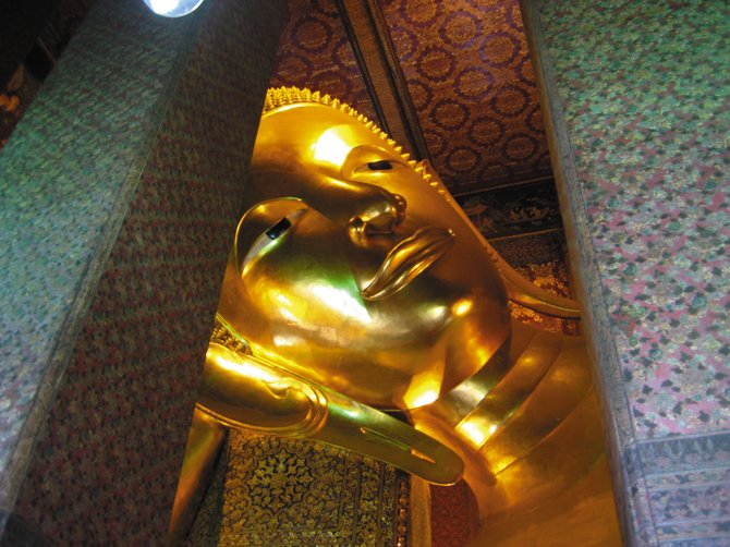 Wat Pho, or the Temple of the Reclining Buddha, is the largest temple in Bangkok. The gold-leaf-plated Buddha is more than 150 feet long.