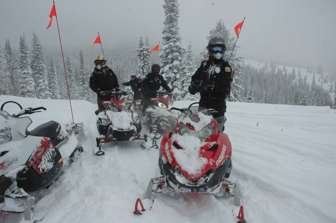 Routt County Sheriff's Office deputies, from left, Kurtis Luster, Mark Mackey and Ryan Adrian, along with Colorado State Parks Ranger Ryan Crabb patrolled Steamboat Ski Area during a relatively subdued April Fools' Day. Local agencies used the typically rowdy day as a chance to complete joint training and keep partiers under control.