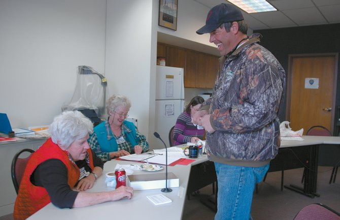 Hayden resident Cody Sweetser chats with election judges, from left, Judy Copeland, Beth Sundberg and Ann Martin during voting Tuesday at Hayden Town Hall. Sweetser said he voted to approve the formation of a home-rule Charter Commission.