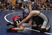 Bad Dog wrestler Kaden Hafey competes Saturday during the Bad Dog's home tournament at MCHS.