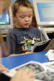East Elementary School kindergartener Gregory Spears reads Thursday in teacher Andi Murphy&#39;s classroom.