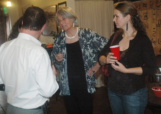 Linda Kakela, center, speaks with guests at a reception in her honor Thursday afternoon at Centennial Hall in downtown Steamboat Springs. Kakela stepped down from her job with the city March 31. She is joined by the Mexican Consulate in Denver Eduardo Arnal, left, and Kakela's daughter, Kate Kakela.