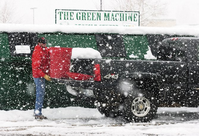 Kevin Male completes his recycling chores at the Green Machine bin in the Alpine Bank parking lot Tuesday.