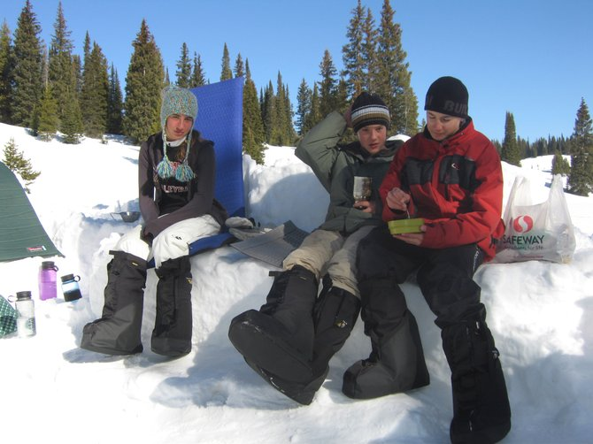 Steamboat Springs Middle School students Dani Perry, from left, Patrick Weston and Michael Savory take a break during an Everything Outdoor Steamboat trip to Rabbit Ears Pass in March 2007. The EOS group was denied a $1,750 request for new sleeping bags because of declining sales tax revenues allocated by the Education Fund Board.