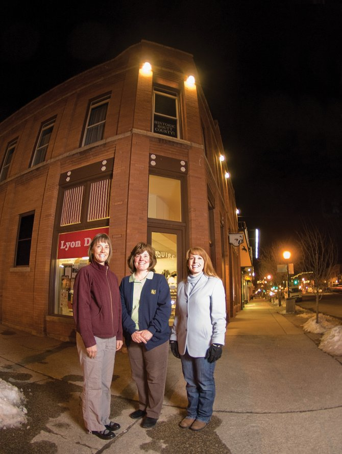 Lyon's Corner Drug & Soda Fountain owners Jennifer Campbelll, from left, Wendy Lyon and Tahnee Miller stand in front of Squire Building, which was built in 1908. The business owners said they would be excited about being a part of a historic district but noted the decision should rest with the building's owner.