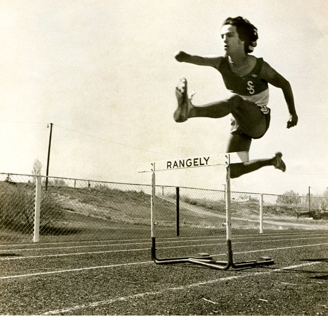 Tom Southall competes in the hurdles during a track meet in 1980. Southall was part of three state track championships and one football state championship during his time in Steamboat Springs.