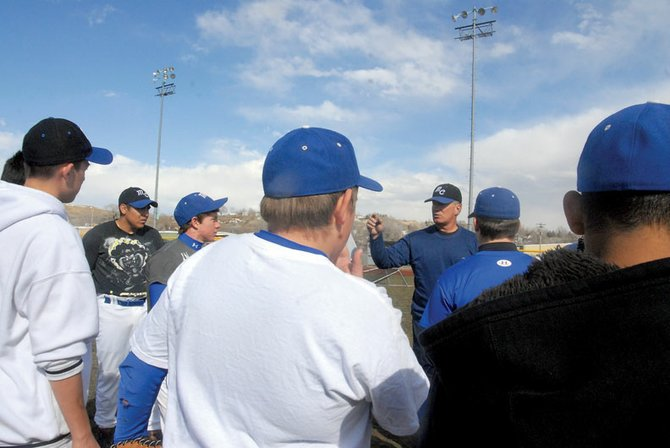 Moffat Count High School baseball head coach Tim Hafey talks with his team Wednesday during practice at Craig Middle School following their double-header Tuesday night against Steamboat Springs in Rifle. The Bulldogs fell to the Sailors, 4-5 and 2-12.