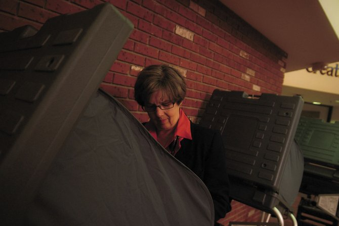 Delaine Voloshin casts her ballot Tuesday during the Craig city election at Centennial Mall, 1111 W. Victory Way. Although Election Day has passed, officials still must conduct a canvass of the results to certify that every vote was accurately counted.