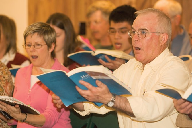 "Loel Hoyle, center, performs at a rehearsal for Handel's ""Messiah"" at the United Methodist Church. Colorado Mountain College will present the production at 6:30 p.m. today, 5:30 p.m. Saturday and 3 p.m. Sunday at the United Methodist Church."