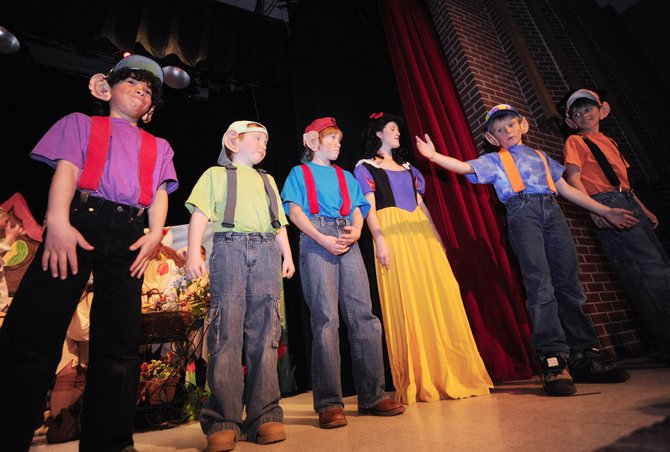 "Hayden Valley Elementary School dwarfs, from left, Mookie Ferguson, Isaiah Lee (who is home-schooled), Micah Lanier, Tyler Hockaday and Trenten Mitchell perform with eighth-grader Morgan Carrico, who played Snow White, on Thursday during a matinee performance of ""The Tale of Snow White."""