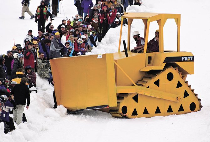 A group of Cardboard Classic event participants attempt to navigate their giant bulldozer made of cardboard down the slope at Steamboat Ski Area during the 2008 Springalicious event.