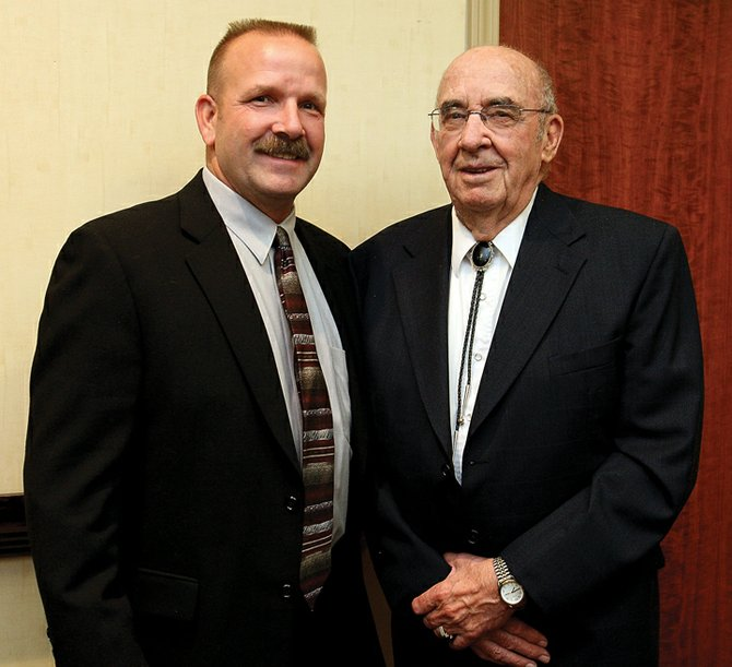 Glen Sherman, right, and his son, John Sherman, pose for a photo at Thursday's Western Colorado Peace Officers Association banquet in Grand Junction. Glen Sherman, a Craig native and former Los Angeles Police Department veteran and Craig police chief, was honored during the banquet. The Peace Officer's Association named its Lifetime Law Enforcement Achievement Award after Glen.