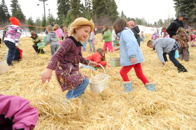 Six-year-old Emi Cooper, daughter of Nat Cooper and Petra Chladek, of Steamboat Springs, looks for Easter eggs Saturday morning during the city of Steamboat Springs' 34th annual Easter egg hunt at Howelsen Hill. Grand Futures Prevention Coalition presented the hunt, which included about 5,000 eggs.