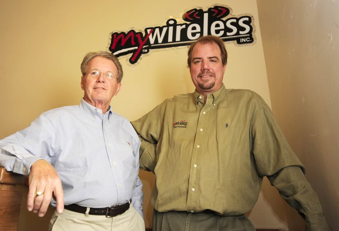 Jim Somerville, left, is talking over as president of Steamboat Springs-based My Wireless, a Verizon Wireless retailer. Founder Andy Brown, right, will focus on marketing, expansion and Web-based services as chairman and CEO.