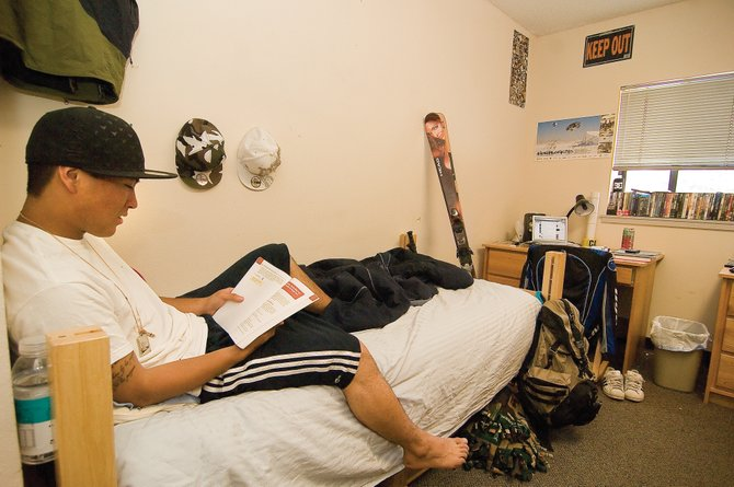 Colorado Mountain College student Alex Sundberg reads inside his dorm room at Hill Hall on the college's Alpine Campus in Steamboat Springs. The room, which is shared by two students, has its own bathroom, as well as access to Internet and cable. There also are student lounges on each floor and a main lounge on the bottom floor.