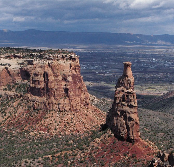 Independence Monument was once part of a continuous wall of sandstone dividing two canyons southwest of Grand Junction in Colorado National Monument.