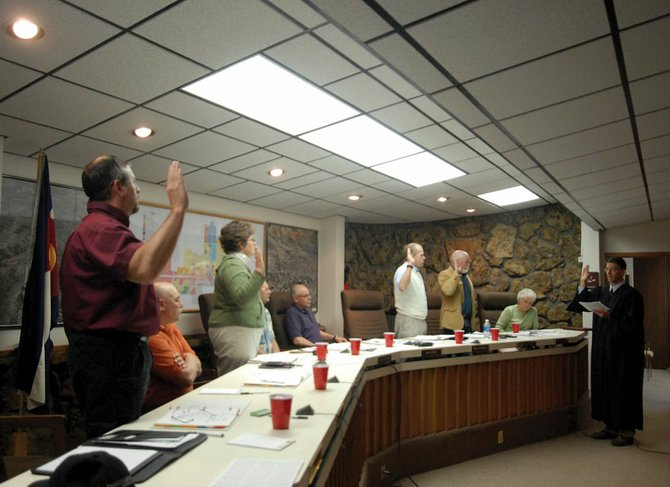 Newly elected Craig City Council members, from left, Byron Willems, Jennifer Riley, Gene Bilodeau and Terry Carwile are sworn in Tuesday by Craig Municipal Court Judge Kevin Peck.
