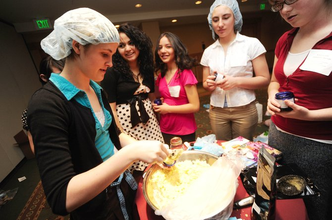 Hayden Middle School eighth-grader Morgan Carrico makes an edible sugar scrub during the Holistic Health workshop held Tuesday morning during the 11th annual Girls to Women Conference at the Steamboat Grand Resort Hotel. The workshop, presented by Little Moon Essentials owner Laura Lamun, was one of nearly 20 workshops held during the morning sessions.