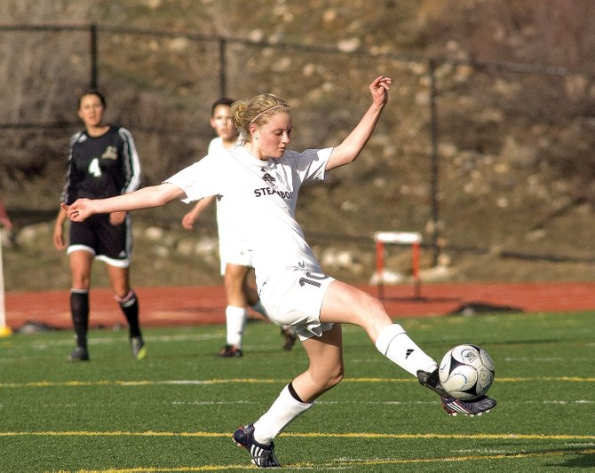 Steamboat Springs' Kiersten Henry passes the ball to a teammate in the first half of Monday's game against Battle Mountain at Gardner Field. Henry scored two goals in the Sailors' 4-1 victory against the Huskies, including the first goal of the game.