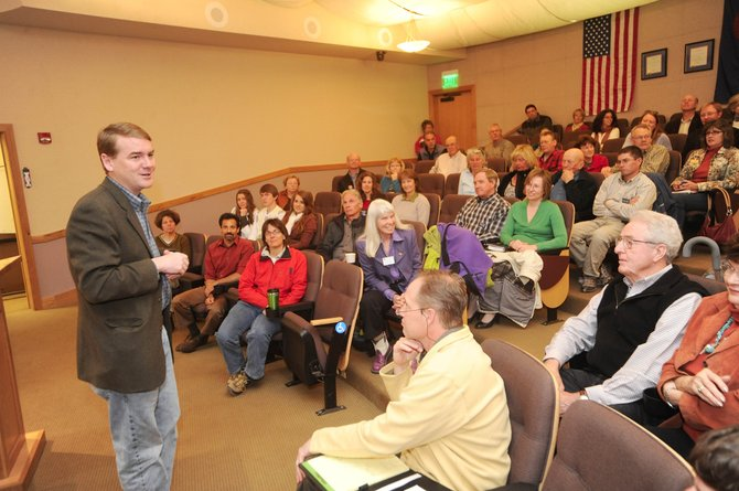 U.S. Sen. Michael Bennet, a Democrat and former superintendent of Denver Public Schools, talks with residents and local officials during a town hall meeting Tuesday morning at Centennial Hall.