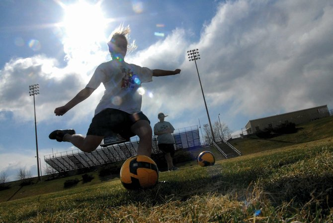 Moffat County High School freshman Kat Thompson takes a shot on goal Wednesday during soccer practice. The girls soccer team hopes to have its first home game of the season, weather permitting, today at 4 p.m. at Woodbury Park.