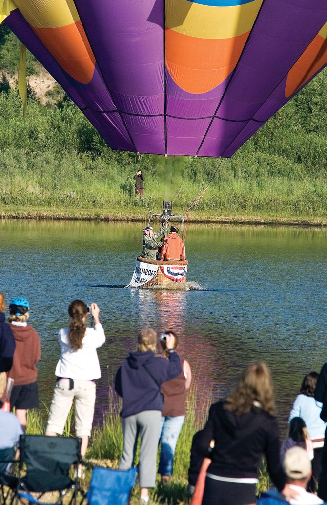 The Will O' The Wind balloon skims across Bald Eagle Lake during the 2007 Hot Air Balloon Rodeo. The Steamboat Springs Chamber Resort Association is using a limited marketing budget to attract visitors to events this summer.