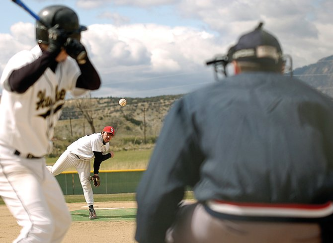 Matt Watwood delivers the ball Saturday in the first game of a baseball doubleheader in Rifle. The Steamboat Springs High School baseball team beat Battle Mountain twice, edging out a 7-6 extra-inning victory and then an 11-0 run-rule rout.