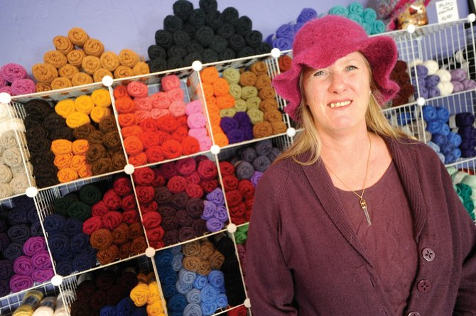 K&K Wools owner Karyn Tussey has sold yarn through her online store for nearly four years. Her shop on Moffat Avenue in Yampa opens formally Monday. Tussey has been working with textiles since her great-grandmother taught her to embroider, telling a 5-year-old Karyn that a woman shouldn't sit with idle hands.