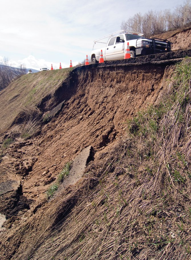 Springs runoff along River Road has caused mud and chunks of pavement to slide down a steep embankment. Paul Draper with the Routt County Road and Bridge Department said crews will begin repair work once conditions allow.