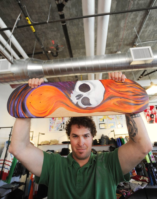 Steamboat Springs artist Dac Ques displays the skate deck he painted for a May 1 First Friday Artwalk group show at Urbane.