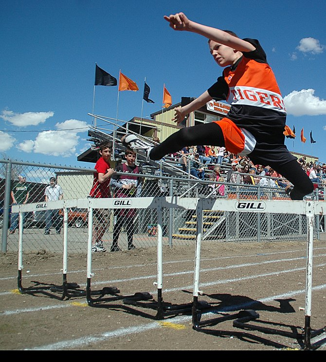 Hayden 6th-grader Thomas Rauch clears a hurdle Wednesday at a track meet in Hayden.