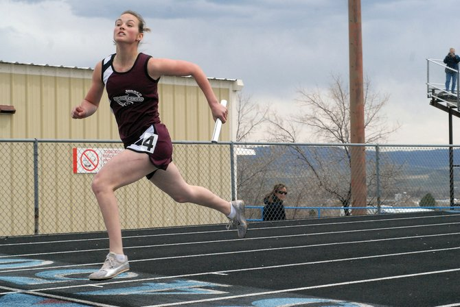 Soroco High School student Sarajane Rossi competes in the girls 800-meter relay during the Clint Wells Invitational track meet Friday in Craig.