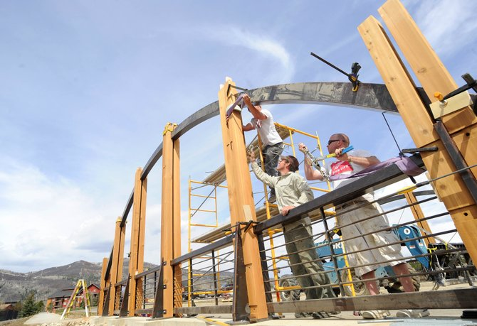 Workers Will Cheesebro, from right, Keith Van Arendonk and Mike Filander construct an entryway bridge for Wildhorse Meadows on Friday afternoon. Cheesebro and Filander are with Habitat Construction, and Van Arendonk works for British Columbia-based Spearhead Timberworks. As the summer construction season approaches, the number of resumes is outpacing the amount of work available in the Steamboat Springs area.