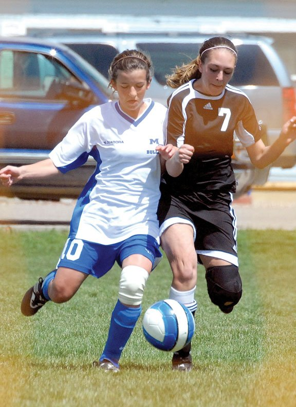 Moffat County High School freshman Kelly Ciesco battles with an Eagle Valley defender Saturday in Craig. Ciesco scored a goal for the Bulldogs in the 3-2 win against the Devils.