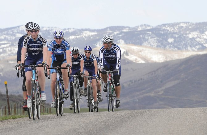Members of the Steamboat Springs Winter Sports Club cycling program take a training ride along Routt County Road 14 on Tuesday afternoon. A bill headed for Gov. Bill Ritter&#39;s desk would require motorists to give cyclists a 3-foot berth when passing them.