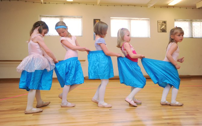 "Let's Dance 5- and 6-year-old dance students, from left, Riley Jacobs, Grace Suddeth, Emily Romero, Brisa Karow and McKenna Waldron rehearse their ""Big Underwear"" dance piece during rehearsal at the Oak Creek dance studio Wednesday. The 16th annual Let's Dance program is 7 p.m. Saturday at Soroco High School."