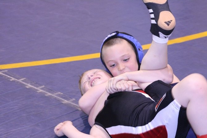 Daniel Caddy locks up his opponent Saturday at a tournament in New Castle. Caddy went on to win the match and earn a 5-1 combined record at the tournament. He placed first and third in his divisions.