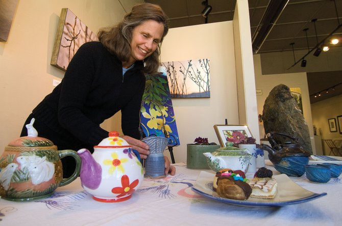 Barb Gregoire sets up a Mother's Day display at the Artists' Gallery of Steamboat earlier this week. Several local artists are featuring their art in the display, which will provide plenty of gift ideas for the upcoming celebration of motherhood.