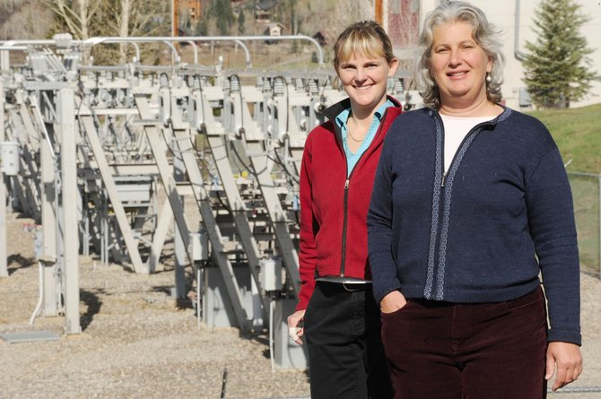 Green energy advocates Susan Holland, right, and Megan Moore-Kemp think more can be done by the Yampa Valley Electric Association to increase the use of renewable energy sources.