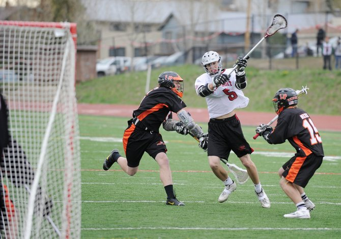 Steamboat Springs High School junior Jack Spady winds up for a shot during Friday's game against Lewis-Palmer High School. Steamboat lost their first-round state playoff game, 16-11.