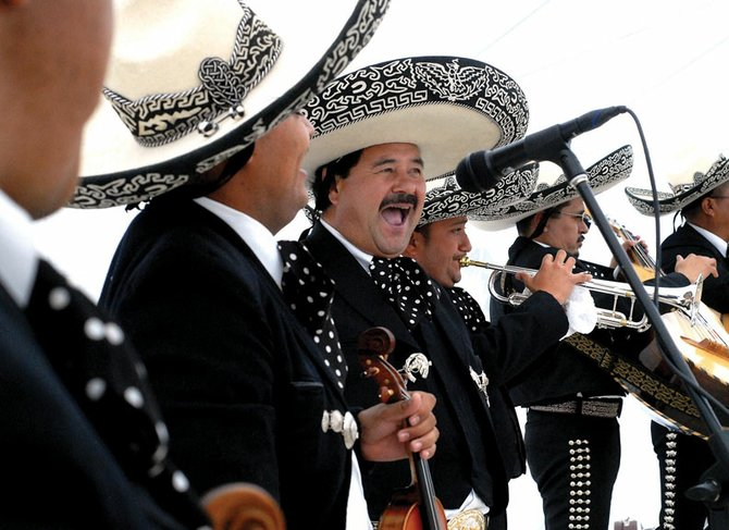Mariachi Regional De Mexico, of Denver, performs Saturday at the Cinco de Mayo celebration at the Wyman Museum. More than 200 people attended the Integrated Community-sponsored event.